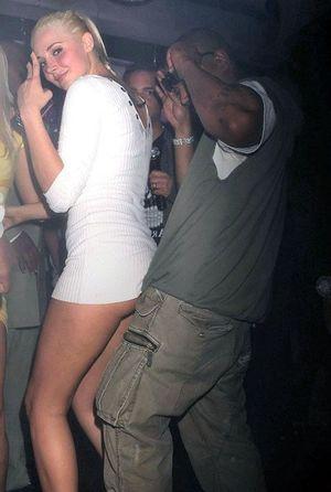 Drunk teen kissing a black man at a..