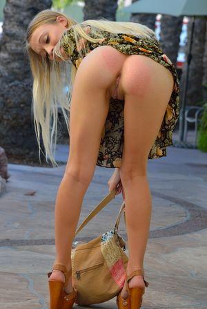 Blonde teen Riley Anne walking along..