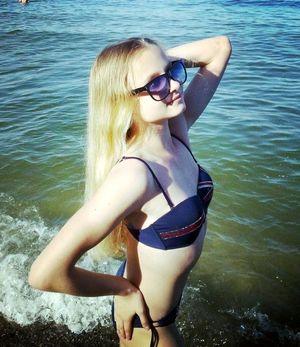 Longhaired flexible teen posing in the..