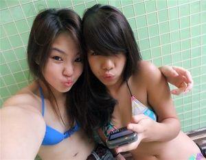 Little Japanese girlfriends on the beach