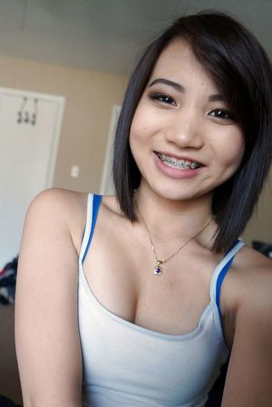 Young asian cuties gives blowjob.